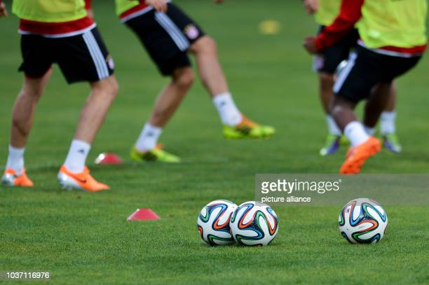 FCBayern Munich's players take part in a training session at the stadium'Stade Adrar' in Agadir Morocco 20December 2013 FCBayern Munich will play...