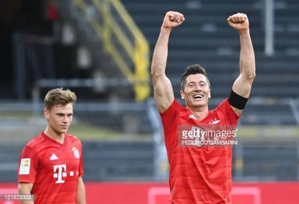 Bayern Munich's Polish forward Robert Lewandowski and Bayern Munich's German midfielder Joshua Kimmich celebrate after the German first division...