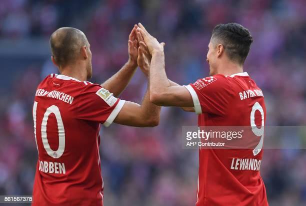 Bayern Munich's Polish forward Robert Lewandowski and Bayern Munich's Dutch midfielder Arjen Robben celebrate after a goal during the German First...