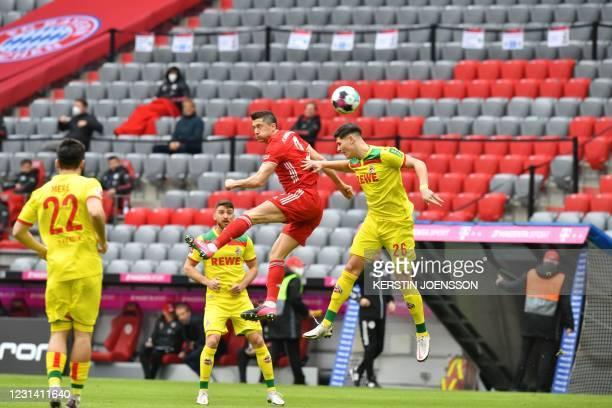 Bayern Munich's Polish forward Robert Lewandowski and Cologne's German defender Sava-Arangel Cestic vie for the ball during the German first division...