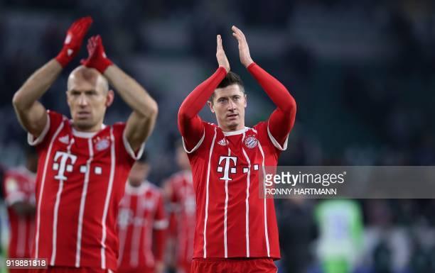 Bayern Munich's Polish forward Robert Lewandowski and Dutch midfielder Arjen Robben applaud the fans after the German first division Bundesliga...