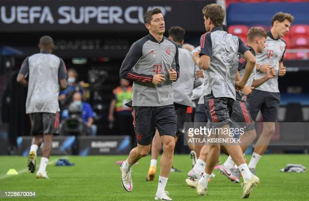 Bayern Munich's Polish forward Robert Lewandowski and his teammates take part in a training sesion on the eve of the UEFA Super Cup football match...