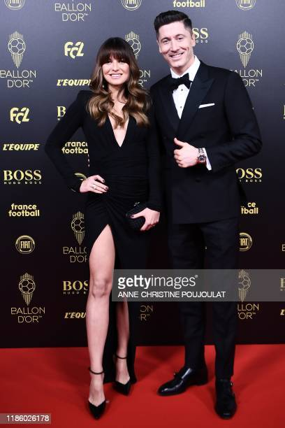 Bayern Munich's Polish forward Robert Lewandowski and his wife Anne Lewandowska arrive to attend the Ballon d'Or France Football 2019 ceremony at the...