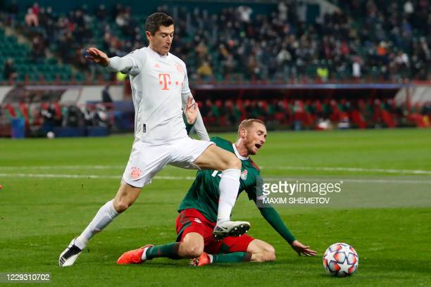 Bayern Munich's Polish forward Robert Lewandowski and Lokomotiv Moscow's Russian midfielder Vladislav Ignatyev vie for the ball during the UEFA...