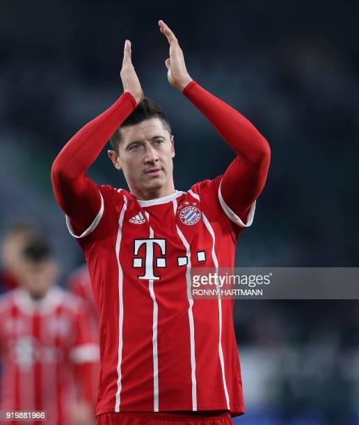 Bayern Munich's Polish forward Robert Lewandowski applauds the fans after the German first division Bundesliga football match VfL Wolfsburg vs FC...
