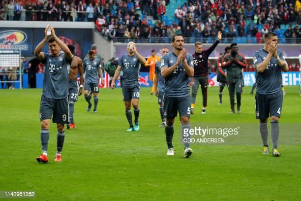 Bayern Munich's Polish forward Robert Lewandowski Bayern Munich's German defender Mats Hummels and Bayern Munich's German defender Niklas Suele react...