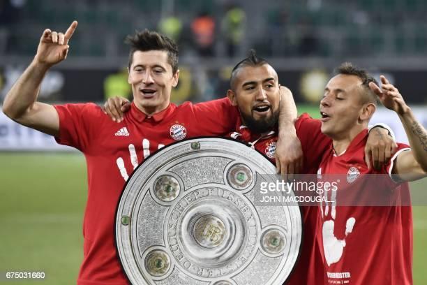 Bayern Munich's Polish forward Robert Lewandowski Bayern Munich's Chilean midfielder Arturo Vidal and Bayern Munich's Brazilian defender Rafinha...