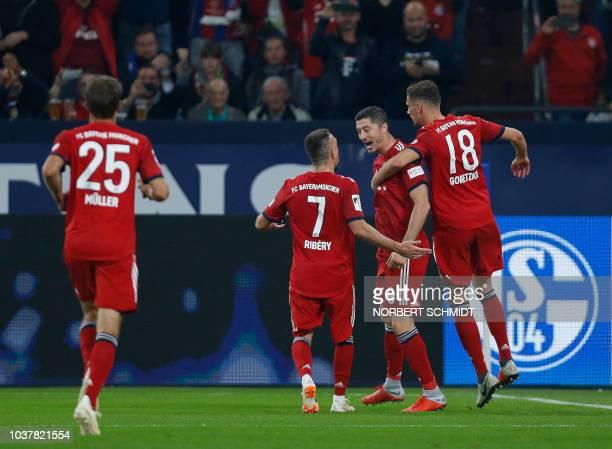 Bayern Munich's Polish forward Robert Lewandowski celebrate after scoring with his teammates during the German First division Bundesliga football...