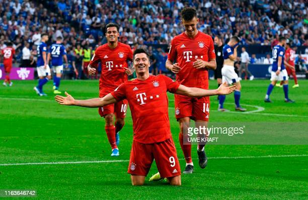 Bayern Munich's Polish forward Robert Lewandowski celebrate scoring his third goal wiht his teammates during the German first division Bundesliga...