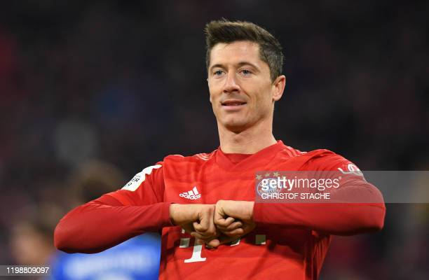 Bayern Munich's Polish forward Robert Lewandowski celebrate scoring during the German Cup round of 16 football match FC Bayern Munich v TSG 1899...