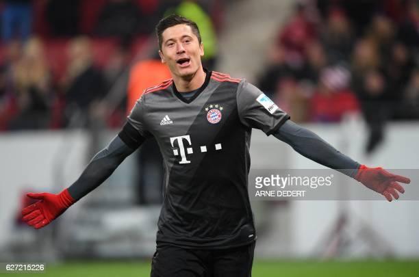 Bayern Munich's Polish forward Robert Lewandowski celebrate scoring during the German first division Bundesliga football match between FSV Mainz 05...