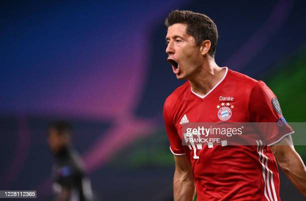 Bayern Munich's Polish forward Robert Lewandowski celebrates after scoring a goal during the UEFA Champions League semifinal football match between...