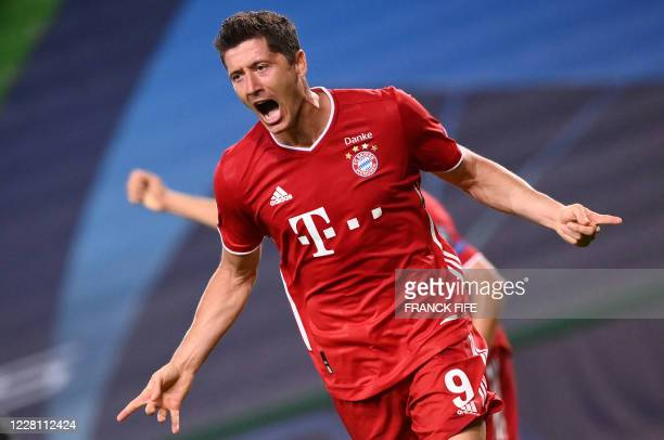 TOPSHOT Bayern Munich's Polish forward Robert Lewandowski celebrates after scoring a goal during the UEFA Champions League semifinal football match...