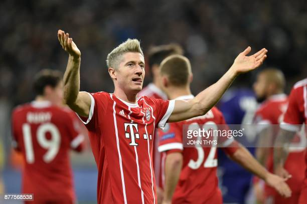 Bayern Munich's Polish forward Robert Lewandowski celebrates after scoring a goal during the UEFA Champions League Group B football match between...