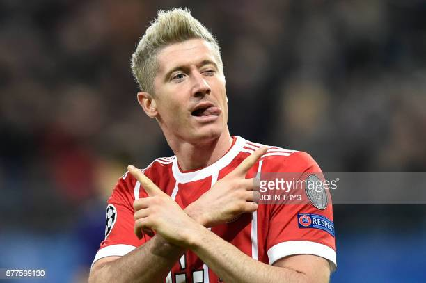TOPSHOT Bayern Munich's Polish forward Robert Lewandowski celebrates after scoring a goal during the UEFA Champions League Group B football match...