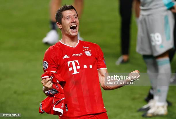 TOPSHOT Bayern Munich's Polish forward Robert Lewandowski celebrates after winning at the end of the UEFA Champions League final football match...