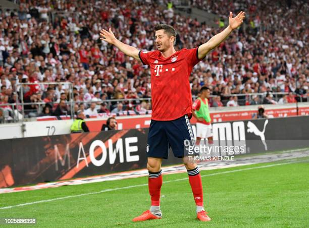 Bayern Munich's Polish forward Robert Lewandowski celebrates after scoring the 02 during the German first division Bundesliga football match VfB...