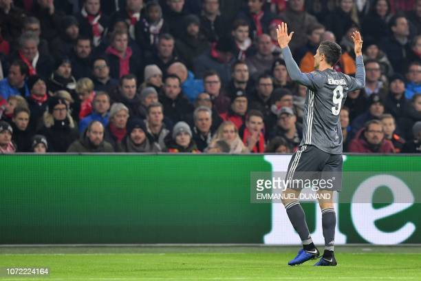 Bayern Munich's Polish forward Robert Lewandowski celebrates after scoring the opener during the UEFA Champions League Group E football match between...