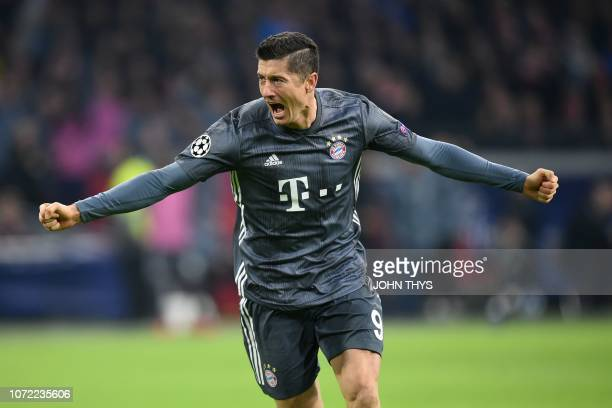 Bayern Munich's Polish forward Robert Lewandowski celebrates after scoring their second goal during the UEFA Champions League Group E football match...