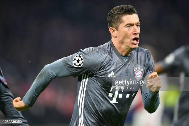 Bayern Munich's Polish forward Robert Lewandowski celebrates after scoring their second goal during the UEFA Champions League Group E football match...