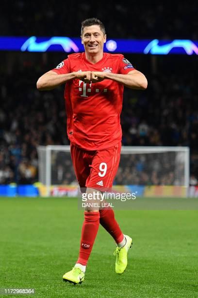 Bayern Munich's Polish forward Robert Lewandowski celebrates after scoring their sixth goal during the UEFA Champions League Group B football match...
