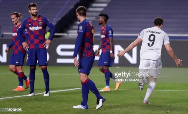 Bayern Munich's Polish forward Robert Lewandowski celebrates after scoring his team's sixth goal during the UEFA Champions League quarter-final...