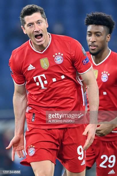 Bayern Munich's Polish forward Robert Lewandowski celebrates after opening the scoring during the UEFA Champions League round of 16 first leg...
