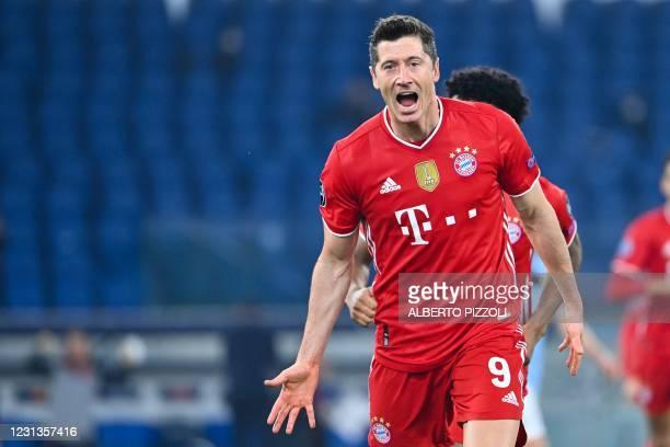 Bayern Munich's Polish forward Robert Lewandowski celebrates after scoring during the UEFA Champions League round of 16 first leg football match...
