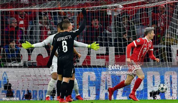 Bayern Munich's Polish forward Robert Lewandowski celebrates after scoring the 10 during the UEFA Champions League football match of Bayern Munich vs...