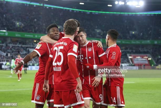 Bayern Munich's Polish forward Robert Lewandowski celebrates after scoring his team's second goal with Austrian midfielder David Alaba German striker...