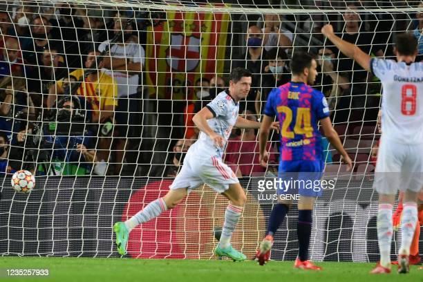 Bayern Munich's Polish forward Robert Lewandowski celebrates his goal during the UEFA Champions League first round group E football match between...