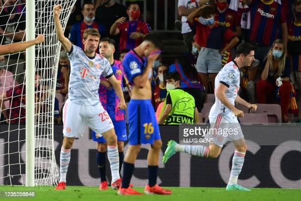 Bayern Munich's Polish forward Robert Lewandowski celebrates his goal with Bayern Munich's German forward Thomas Mueller during the UEFA Champions...
