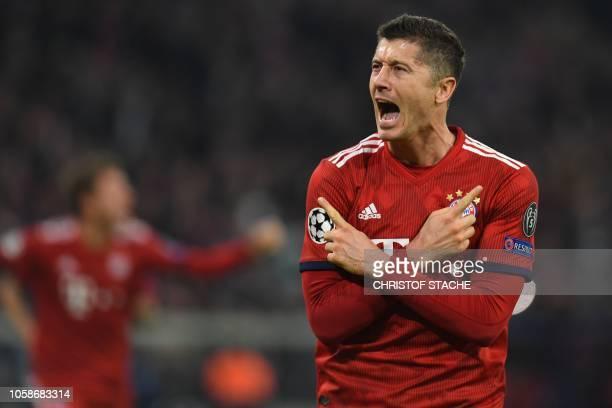 Bayern Munich's Polish forward Robert Lewandowski celebrates scoring the opening goal during the UEFA Champions League Group E football match Bayern...