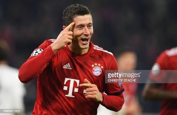 Bayern Munich's Polish forward Robert Lewandowski celebrates scoring the 41 goal during the UEFA Champions League Group E football match Bayern...