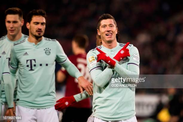 Bayern Munich's Polish forward Robert Lewandowski celebrates scoring his team's 4th goal during the German first division Bundesliga football match...