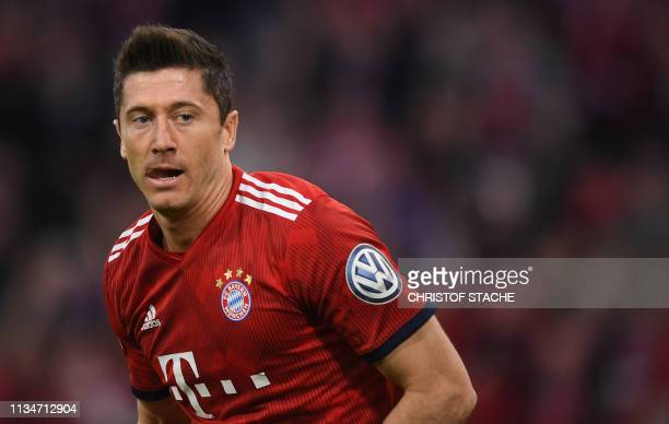 Bayern Munich's Polish forward Robert Lewandowski celebrates scoring during the German Cup quarter-final football match FC Bayern Munich v FC...