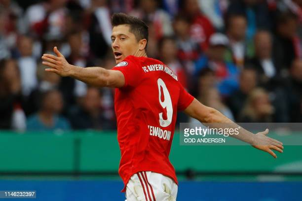 Bayern Munich's Polish forward Robert Lewandowski celebrates scoring the opening goal during the German Cup Final football match RB Leipzig v FC...