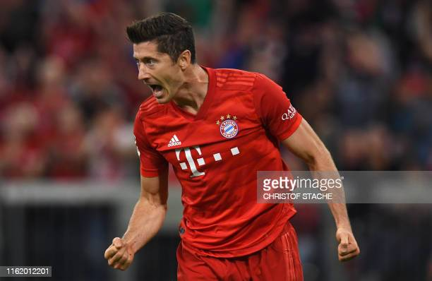 Bayern Munich's Polish forward Robert Lewandowski celebrates scoring the opening goal during the German First division Bundesliga football match FC...