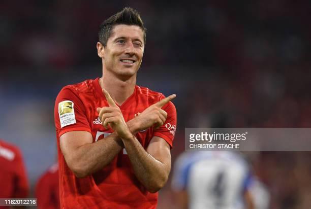 Bayern Munich's Polish forward Robert Lewandowski celebrates scoring the opening goal during the German First division Bundesliga football match FC...