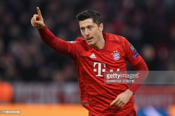 Bayern Munich's Polish forward Robert Lewandowski celebrates scoring the opening goal during the UEFA Champions League Group B football match FC...