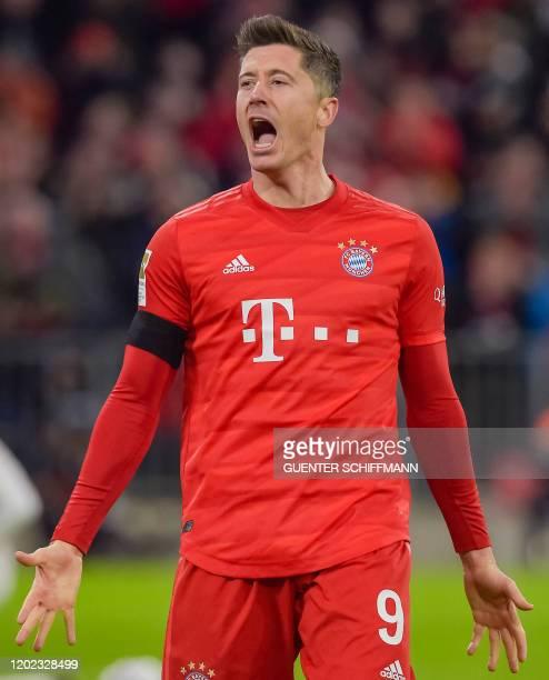 Bayern Munich's Polish forward Robert Lewandowski celebrates scoring during the German first division Bundesliga football match FC Bayern Munich v SC...