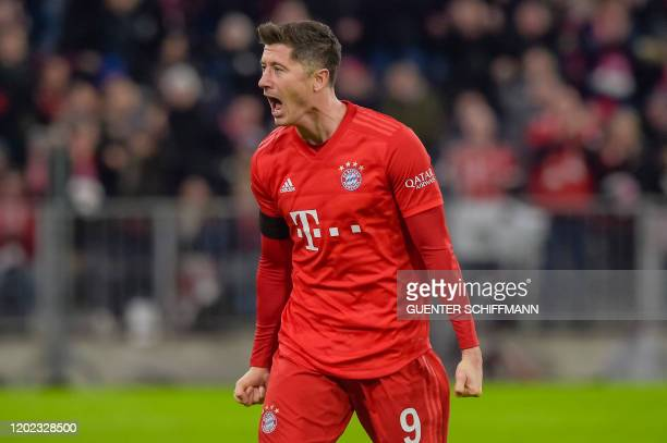 Bayern Munich's Polish forward Robert Lewandowski celebrates scoring during the German first division Bundesliga football match FC Bayern Munich v SC...