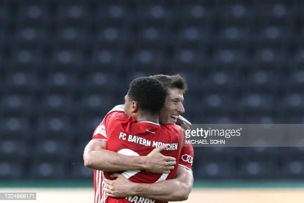 Bayern Munich's Polish forward Robert Lewandowski celebrates scoring the 0-3 goal with Bayern Munich's German midfielder Serge Gnabry during the...