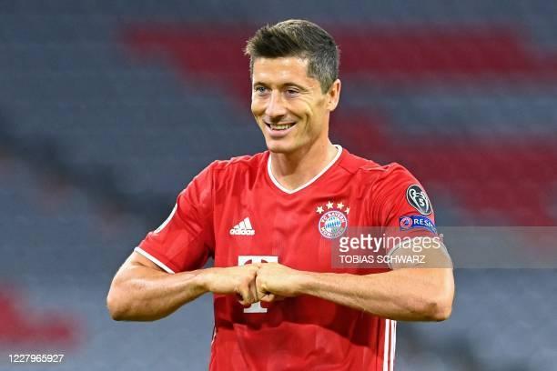 Bayern Munich's Polish forward Robert Lewandowski celebrates scoring his team's first goal during the UEFA Champions League, second-leg round of 16,...