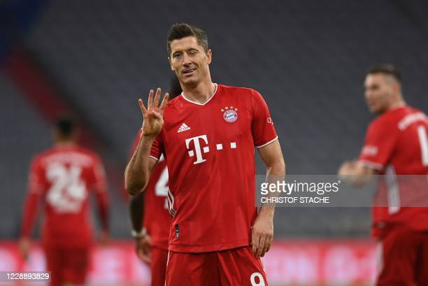 TOPSHOT Bayern Munich's Polish forward Robert Lewandowski celebrates scoring from the penalty spot his team's forth goal to lead and win 43 during...