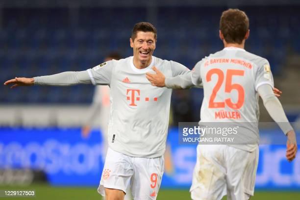 Bayern Munich's Polish forward Robert Lewandowski celebrates scoring the 03 goal with Bayern Munich's German forward Thomas Mueller during the German...