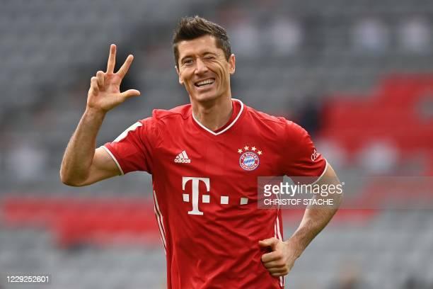 Bayern Munich's Polish forward Robert Lewandowski celebrates scoring the 3-0 goal for his hat-trick during the German first division Bundesliga...