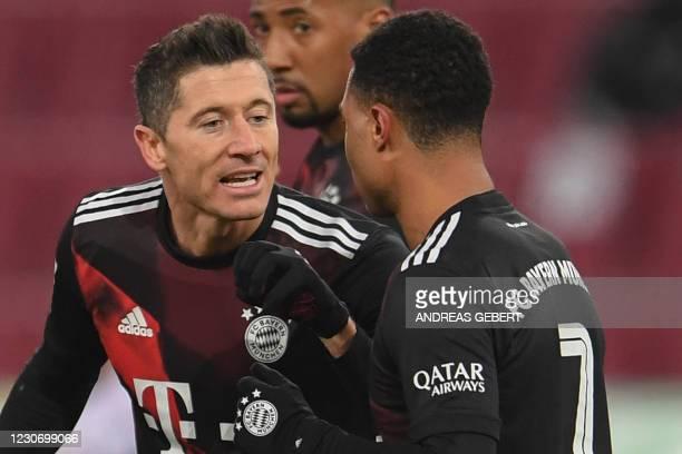 Bayern Munich's Polish forward Robert Lewandowski celebrates scoring the opening goal with his teammate Bayern Munich's German midfielder Serge...
