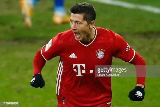Bayern Munich's Polish forward Robert Lewandowski celebrates scoring the 0-2 goal during the German first division Bundesliga football match Schalke...