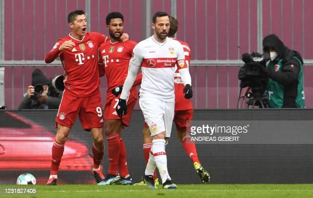Bayern Munich's Polish forward Robert Lewandowski celebrates scoring his team's first goal during the German first division Bundesliga football match...